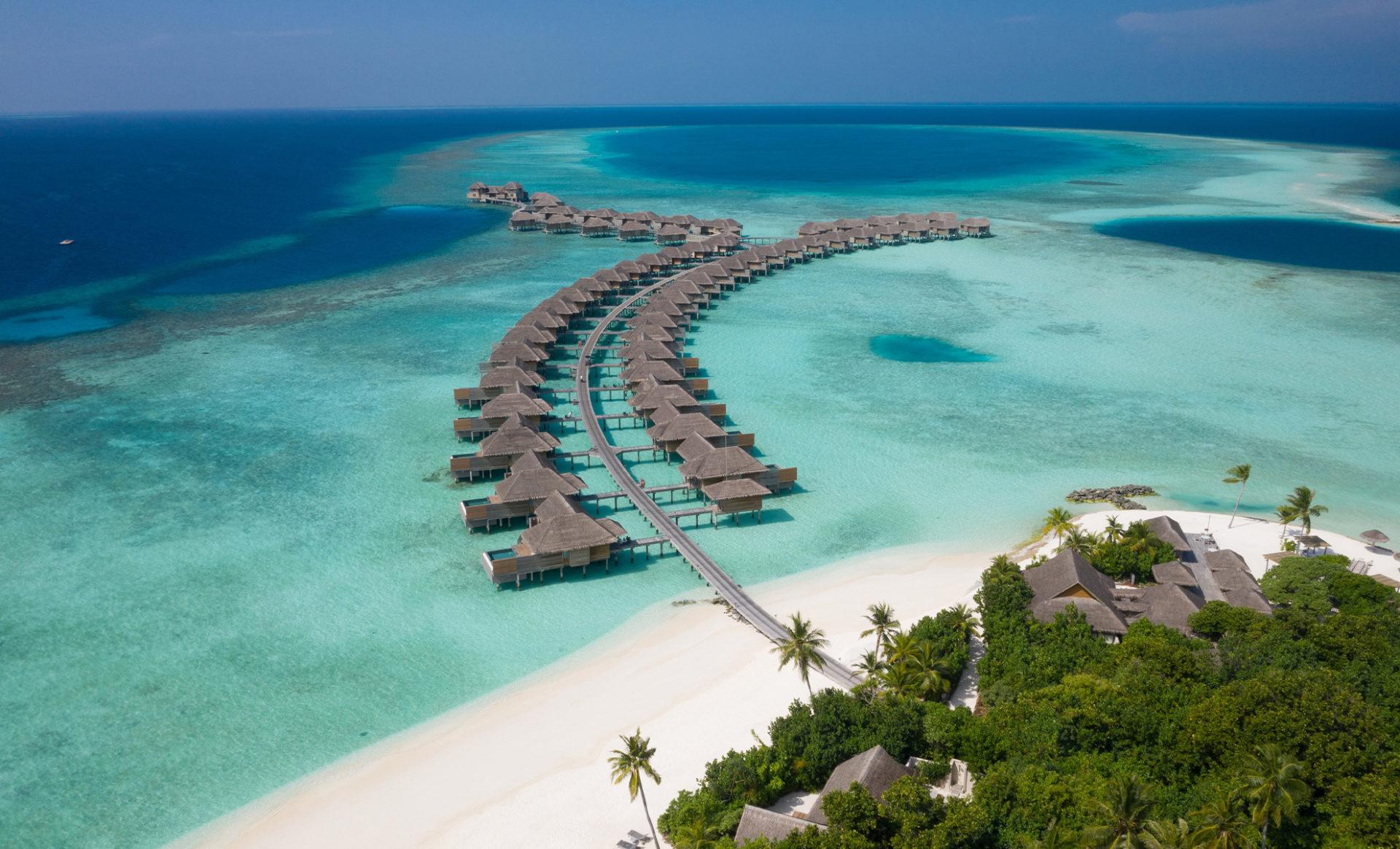 VAKKARU-MALDIVES-Aerial_over-water-villa-1920x1164